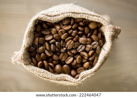 top view of coffee beans in burlap sack - stock photo