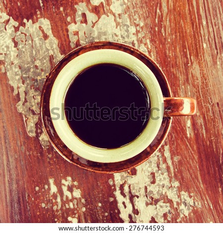 Top view of coffee cup on wood table. (Vintage process tone) - stock photo