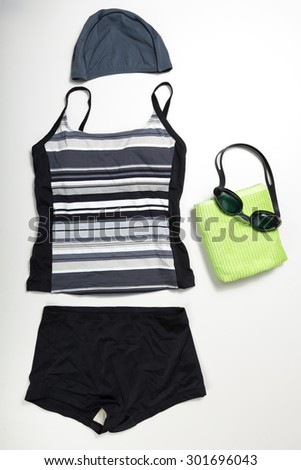 top view of collection of Swimming suit, caps and glasses - stock photo