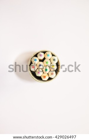 Top view of color pencils  on soft pink background top view - stock photo