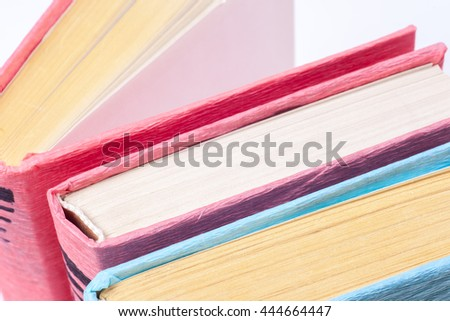 Top view of colorful hardback books in a circle. Open book, fanned pages isolated on white background, free copy space. Back to school copy space. Education background. - stock photo