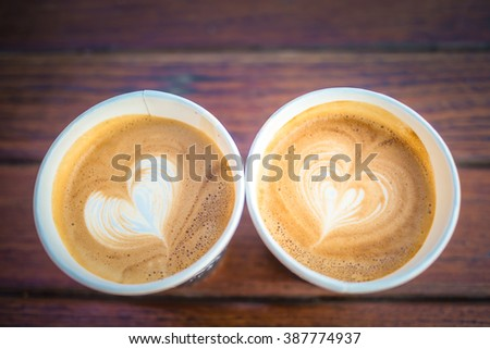 Top View of Couple Coffee Cup Selective Focus on the Microfoam - stock photo