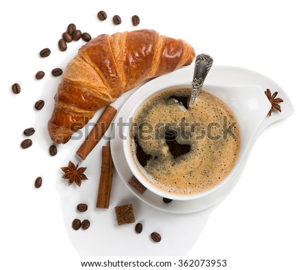 Top view of cup of coffee with coffee beans, anise, cinnamon sticks and croissant isolated on white background - stock photo