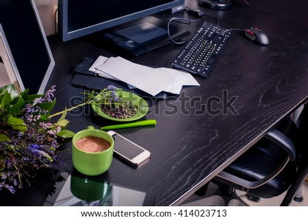 top view of desktop. home Office. work at home. personal belongings on a black table. against the dark wood. good morning pleasant working.  - stock photo
