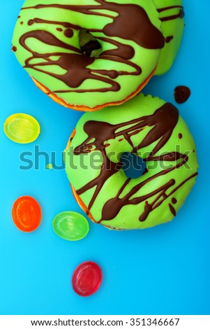 top view of donuts isolated on blue background - stock photo