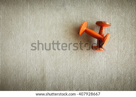 Top view of dumbbell exercise weights on the floor at fitness gym vintage tone. - stock photo