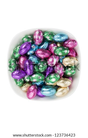 Top view of Easter candies in a bowl. - stock photo