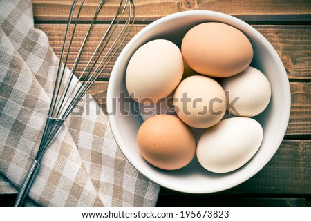 top view of eggs in bowl - stock photo