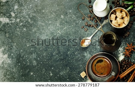 Top view of Espresso coffee, milk and sugar on black marble table. Background with space for text. - stock photo