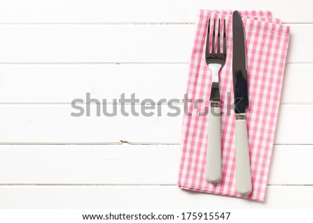 top view of fork and knife on checkered napkin - stock photo