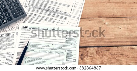 top view of forms for usa taxes with a pen and an electronic calculator, empty spaces for custom text at the right (3d render) - stock photo