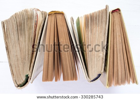 Top view of  four hardback books in a row.  Education background. - stock photo