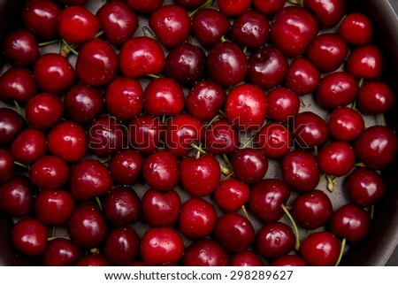 Top view of fresh red cherry with water drops  - stock photo