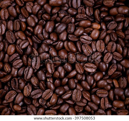 Top view of freshly roasted coffee beans in filled frame format.  - stock photo