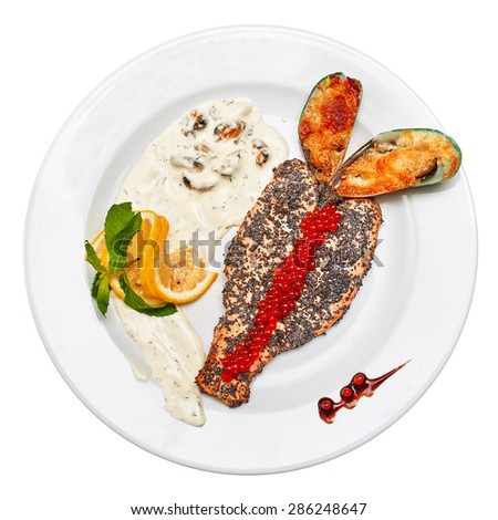 Top view of Fried red fish in poppy seeds with lemon and creamy mushroom sauce. Fried mussels with cheese and red caviar. On a white background - stock photo