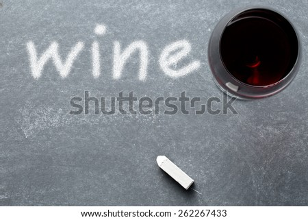 top view of glass of wine on chalkboard - stock photo