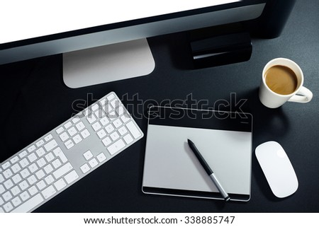 Top view of graphic designer's workspace - stock photo
