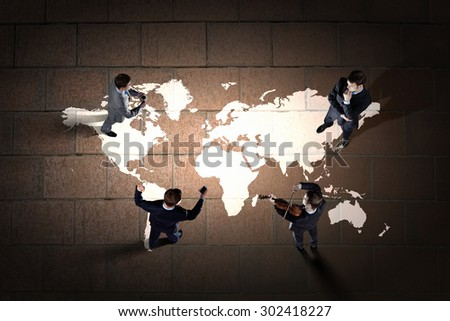 Top view of group of business people standing in circle - stock photo