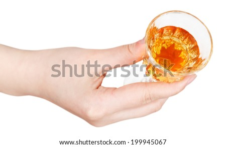 top view of hand holding glass of dessert wine isolated on white background - stock photo