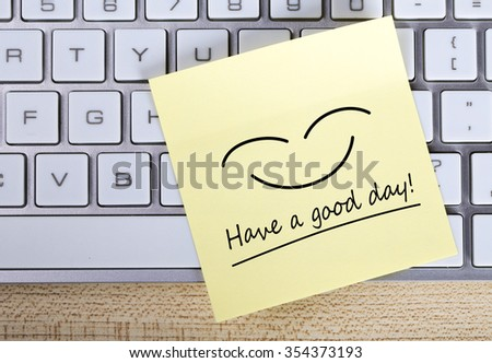 Top view of Have a good day sticky note pasted on the keyboard. - stock photo