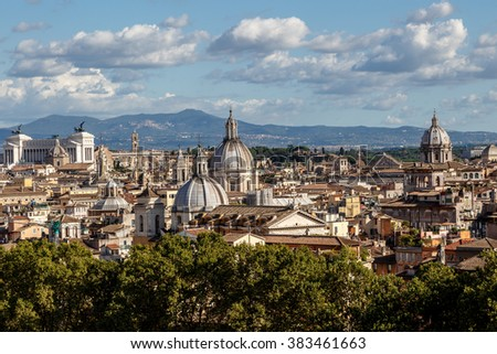 Top view of historical city of Rome with domes, on cloudy blue sky background. - stock photo