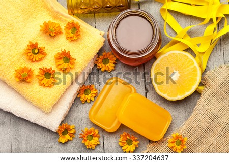 Top view of honey soap with lemon over wooden table - stock photo