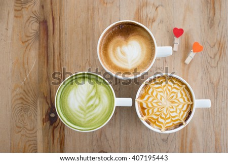 Top view of hot milk art coffee and green tea latte  , Collection of vintage latte art coffee - stock photo