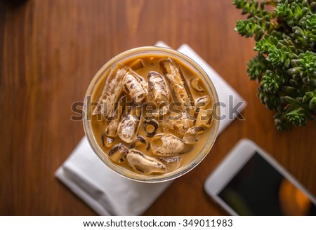 Top view of iced coffee on wooden table - stock photo