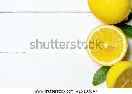 Top view of lemons on wood table with copyspace - stock photo