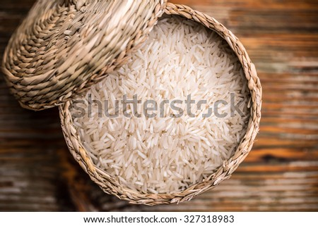 Top view of long grain rice in a wicker basket - stock photo