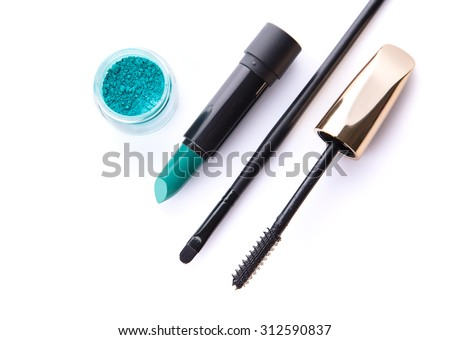 Top view of loose eye shadow, lipstick, makeup brush, and mascara, isolated on white background  - stock photo