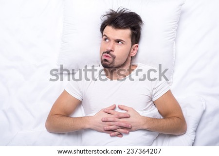 Top view of man is trying to fall asleep. - stock photo