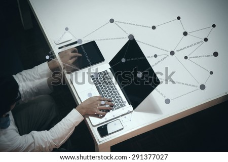 top view of man working with business documents on office table with digital tablet and man working with smart laptop computer