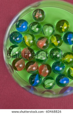 Top View of Marbles in Container - stock photo