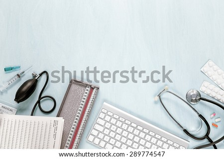 top view of medical equipment on a blue desk - stock photo