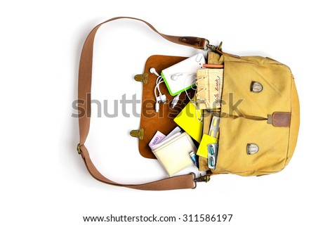 Top view of Men Bag with essentials for modern young person on white table .leather bag, smartphone,power bank, notepad, book,keys, medicine pills with Condom Concept for Save sex - stock photo