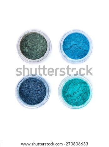Top view of mineral eye shadows in pastel colors, top view isolated on white background  - stock photo