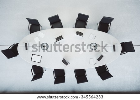 Top view of modern conference room with oval table 3D Render - stock photo