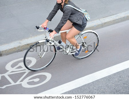 Top view of motion blurred bicyclist in bike lane - stock photo