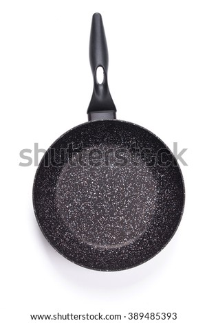 Top view of new empty frying pan isolated on white... - stock photo