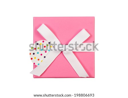 Top view of new pink color wrapped gift box and white bow isolated on white  - stock photo