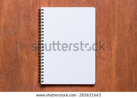Top view of note book on wooden table - stock photo