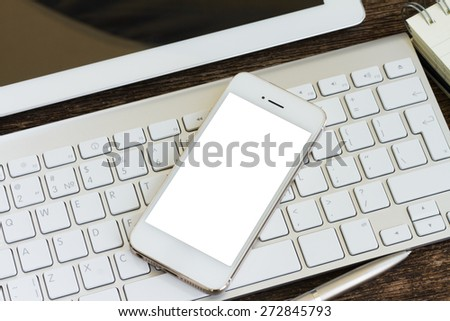 Top view of office workplace -   keyboard and phone on wooden background, copy space on screen  - stock photo