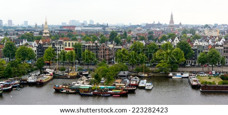 Top view of old Amsterdam city at summer - stock photo