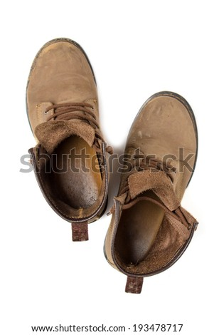 Top view of old and dirty boots isolated on white background - stock photo
