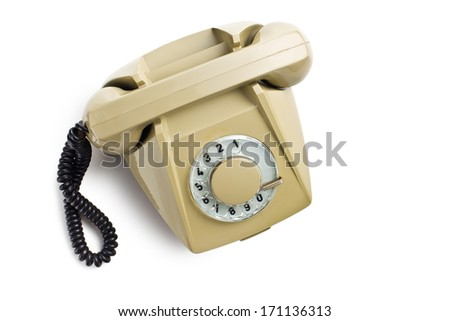 top view of old beige telephone on white background - stock photo