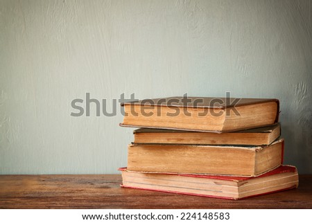 Top view of old books on a wooden table. retro filtered image  - stock photo