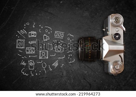 top view of old camera over blackboard and infographics sketches.  - stock photo
