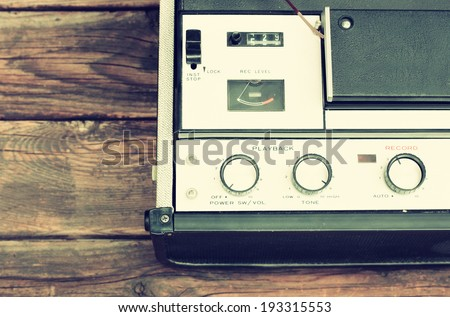 top view of old reel to reel recorder, filtered image - stock photo
