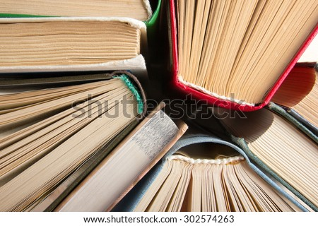 Top view of old used colorful hardback books. Back to school. - stock photo